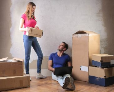 couple-with-boxes-in-a-new-house-PD6AZHY